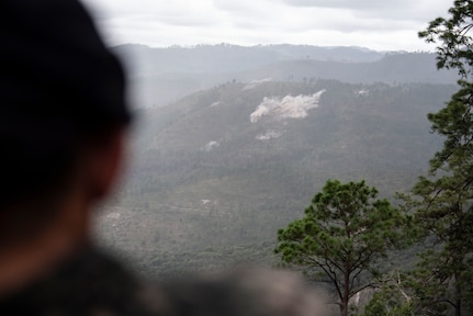 A Honduran soldier watches a demonstration during Artillery Day at Zambrano, Dec. 4, 2018.