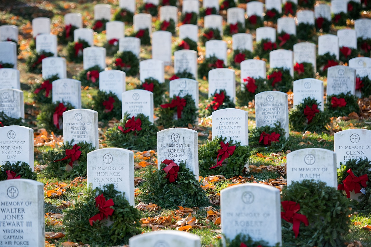 Wreaths on graves at Arlington National Cemetery.