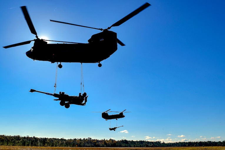 Helicopters carry large howitzer guns.