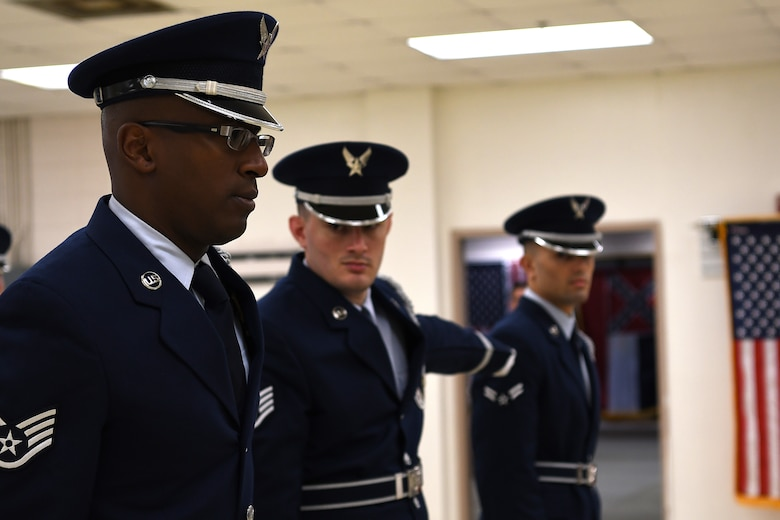 U.S. Air Force Staff Sgt. Michael Williams, Staff Sgt. Dalton Kirby, and Airman 1st Class Brandon Ahuna, Keesler Air Force Base Honor Guard members, participate in an open ranks inspection inside the honor guard building at Keesler Air Force Base, Mississippi, Nov. 29, 2018. Honor guard members practice four out of five working days to execute precise movements for future details. (U.S. Air Force photo by Airman 1st Class Suzie Plotnikov)