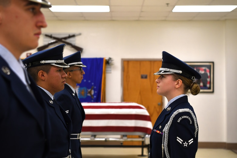 U.S. Air Force Airman 1st Class Brandy Michaud, Keesler Air Force Base Honor Guard member, inspects Airmen during an open ranks inspection inside the honor guard building at Keesler Air Force Base, Mississippi, Nov. 29, 2018. Honor guard members practice four out of five working days to execute precise movements for future details. (U.S. Air Force photo by Airman 1st Class Suzie Plotnikov)