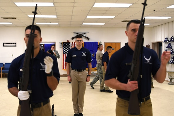 U.S. Air Force Airman 1st Class Brandon Ahuna, Senior Airman Frederick Taylor and Airman 1st Class Miklo Miller, Keesler Air Force Base Honor Guard members, practice rifle movements inside the honor guard building at Keesler Air Force Base, Mississippi, Nov. 29, 2018. Honor guardsmen practice four out of five working days to execute precise movements for future details. (U.S. Air Force photo by Airman 1st Class Suzie Plotnikov)