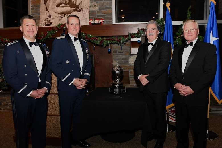 Lt. Col. Michael, Maj. Gen. Peter Gersten, David Alexander, and Larry Stutzriem stand together during the General Atomics' MQ-1B/9 Squadron of the Year awards presentation at Mount Rushmore in Keystone, S.D., Dec. 7, 2018. The 89th Attack Squadron, a tenant unit at Ellsworth Air Force Base, won this year's award. Michael is the 89th ATKS commander; Gersten is the U.S. Air Force Warfare Center commander; Alexander is the General Atomics Aeronautical Systems Inc. aircraft systems business unit president; and Stutzriem is the Mitchell Institute for Aerospace studies director of research. (U.S. Air Force photo by Senior Airman Denise Jenson)