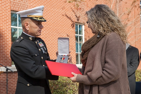 The Navy and Marine Corps Medal and citation are posthumously awarded to Lance Cpl. Nicholas R. Smarr, a Reserve Marine killed in the line of duty while serving as a police officer for the Americus Police Department in Americus, Ga., Dec. 7, 2018. The Navy and Marine Corps Medal is the highest non-combat decoration awarded for heroism by the Department of Defense. (U.S. Marine Corps photo by Cpl. Niles Lee)