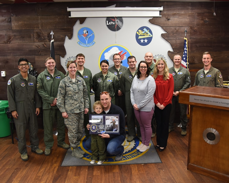 "Tobias Taylor, Pilot for a Day, and his family pose with members of Team BLAZE and local business leaders Dec. 6, 2018, on Columbus Air Force Base, Mississippi. Pilot for a Day is a program where medically disabled youth get a ""red carpet day"" custom-tailored to their desires and capabilities. (U.S. Air Force photo by Melissa Doublin)"