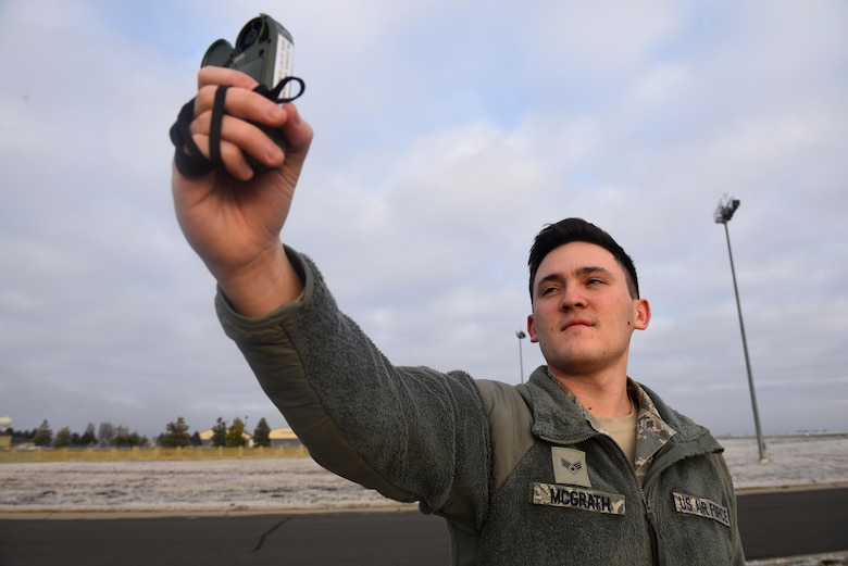Senior Airman Christopher McGrath, 92nd Operation Support Squadron weather flight forecaster journeyman, uses a Kestrel Weather Meter Dec. 4, 2018, at Fairchild Air Force Base, Washington. A Kestrel Weather Meter is a handheld wind and weather meter that provides the speed of the wind, the temperature, humidity and heat stress information. (U.S. Air Force photo/Airman 1st Class Lawrence Sena)