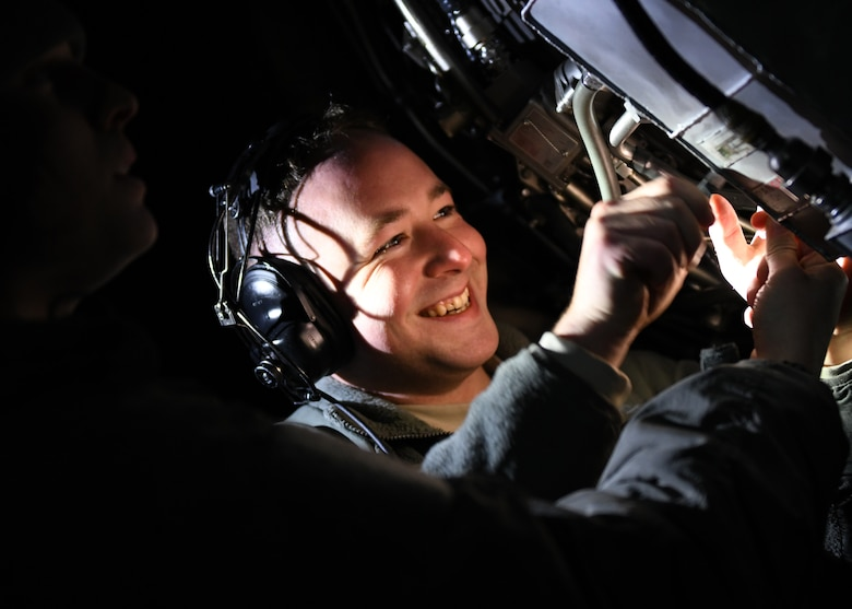 Senior Airman Zachary Rogers, a 28th Aircraft Maintenance Squadron aerospace propulsion journeyman, smiles as he performs maintenance on a grounded B-1B Lancer at Ellsworth Air Force Base, S.D., Dec. 4, 2018. Aerospace propulsion, hydraulic systems, crew chiefs and avionics all work together in their area of expertise to ensure the aircraft is properly maintained and ready to fly. (U.S. Air Force photo by Senior Airman Denise Jenson)