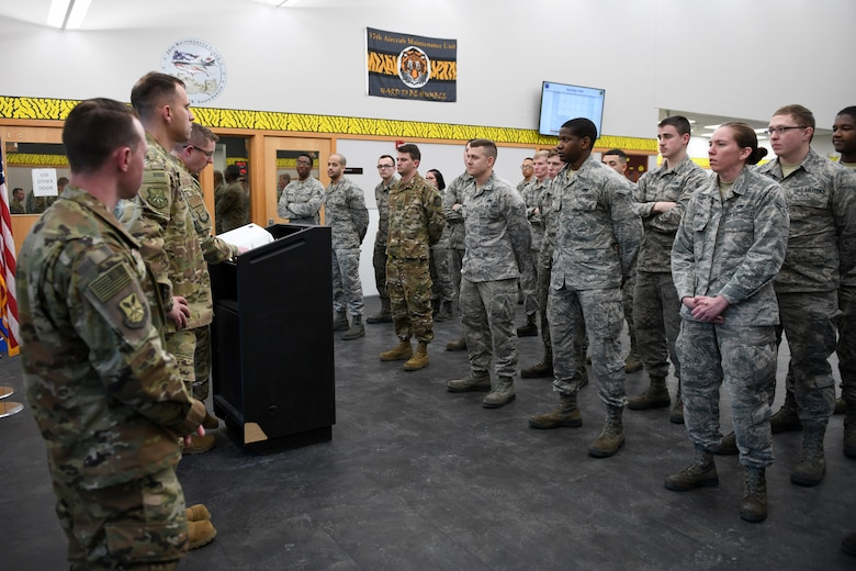 Airmen from the 28th Aircraft Maintenance Squadron receive a briefing during their roll call at shift change on Ellsworth Air Force Base, S.D., Dec. 4, 2018. During shift change, the Airmen are briefed on current weather conditions and different events going on around the squadron. (U.S. Air Force photo by Senior Airman Denise Jenson