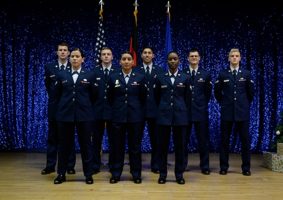 Airmen from Honor Guard Class 18-D pose after graduation at the Community Center on Spangdahlem Air Base, Germany, December 7, 2018. Airmen from the 52nd Fighter Wing and 86th Airlift Wing, Ramstein AB, trained on more than 60 variations of facing and drill movements during the week long training. (U.S. Air Force photo by Senior Airman Dawn M. Weber)
