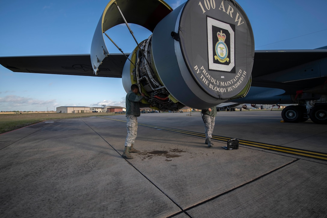 U.S. Air Force Tech. Sgt. Torrey Sanchez, 100th Aircraft Maintenance Squadron aerospace propulsion lead technician, and Senior Airman Ian Hernandez-Mancilla, 100th AMXS aerospace propulsion journeyman, inspect a KC-135 Stratotanker engine at RAF Mildenhall, England, Nov. 30, 2018. The aerospace propulsion Airmen's success is exemplified through the Bloody Hundredth's mission as a ready force and strategic forward base, projecting airpower through unrivaled air refueling across Europe and Africa. (U.S. Air Force photo by Senior Airman Luke Milano)