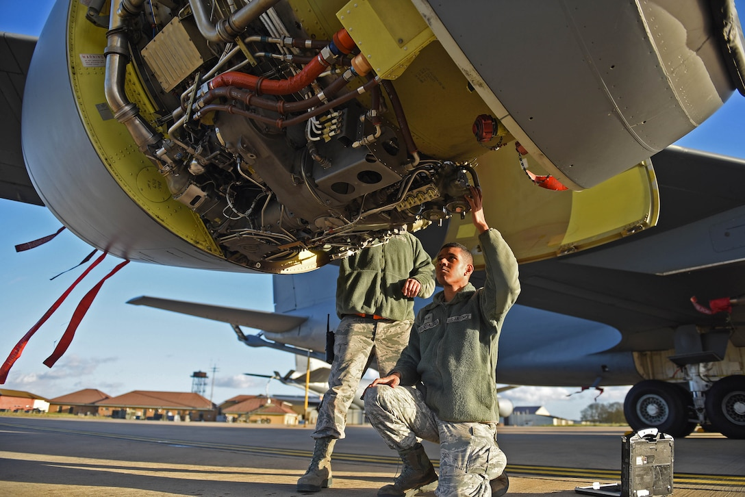 U.S. Air Force Tech. Sgt. Torrey Sanchez, 100th Aircraft Maintenance Squadron aerospace propulsion lead technician, and Senior Airman Ian Hernandez-Mancilla, 100th AMXS aerospace propulsion journeyman, inspects a KC-135 Stratotanker engine at RAF Mildenhall, England, Nov. 30, 2018. The aerospace propulsion Airmen's success is exemplified through the Bloody Hundredth's mission as a ready force and strategic forward base, projecting airpower through unrivaled air refueling across Europe and Africa. (U.S. Air Force photo by Senior Airman Luke Milano)