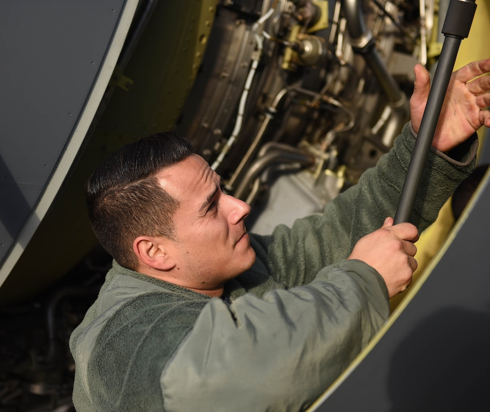 U.S. Air Force Tech. Sgt. Torrey Sanchez, 100th Aircraft Maintenance Squadron aerospace propulsion lead technician, closes a hatch on a KC-135 Stratotanker engine at RAF Mildenhall, England, Nov. 30, 2018. The aerospace propulsion shop maintains the engines, as well as conducts periodic inspections and unscheduled maintenance. (U.S. Air Force photo by Senior Airman Luke Milano)