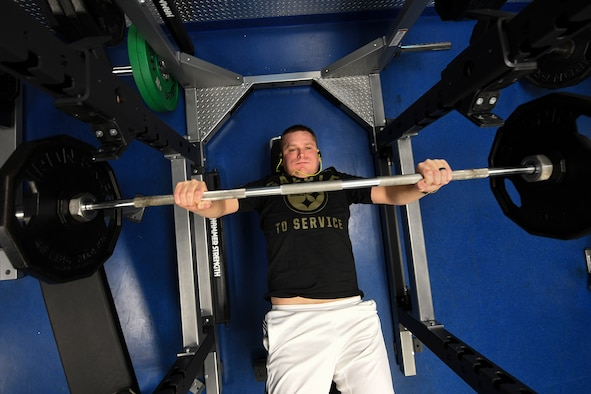 Maj. Christopher Repin, operations officer with the 2nd Infantry Brigade Combat Team, performs a declined bench press repetition at Pittsburgh IAP ARS, Pa., December 11, 2018. The 911th Airlift Wing Fitness Center replaced some of their old equipment with brand new equipment at the end of November, this includes all brand new gym equipment in the free-weight room. (U.S. Air Force photo by Joshua J. Seybert)