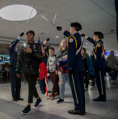Students from the Alton High School JROTC program salute Gold Star families as they as they start their four day trip to Disney World as part of the Snow Ball Express Dec. 8, 2018 at the St. Louis-Lambert airport in St. Louis, Missouri.