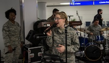 The band Starlifter, part of the Band of Mid-America, performs for Gold Star families during the Snow Ball Express at the St. Louis-Lambert airport, Dec. 8, 2018, in St. Louis, Missouri. The Snow Ball Express is an event organized to give Gold Star families a four-day trip to Disney World in Orlando, Florida. The trip is sponsored by the Gary Sinise Foundation and American Airlines.