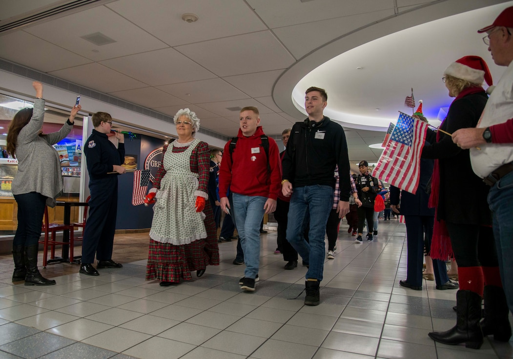 Gold Star families are cheered on as they enter the St. Louis-Lambert airport Dec. 8, 2018 in St. Louis, Missouri. Families from all over the country were flown to Disney World in Orlando, Florida, as part of the Snow Ball Express, a four-day trip sponsored by the Gary Sinise Foundation and American Airlines to honor Gold Star families.