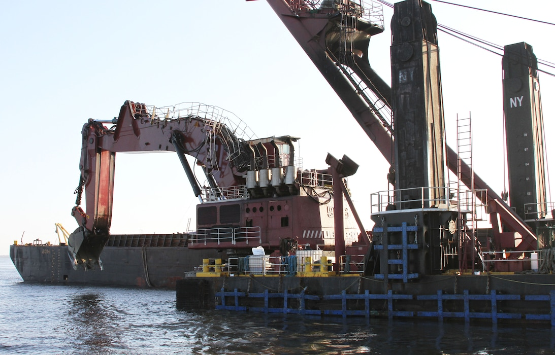 The mechanical dredge NEW YORK, owned and operated by Great Lakes Dredge & Dock Company, removes rock material from the Delaware River as part of the project to deepen the channel from 40 to 45 feet.