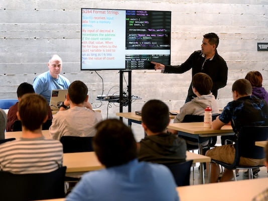 Staff Sgt. Justin Gonzalez, 33rd Network Warfare Squadron  incident response operator, and GhostWire Academy course developer and co-founder, hosts a Network+ class in San Antonio, Oct. 21, 2018. The academy is a free cyber certification training and award organization which serves San Antonio teenagers. (U.S. Air Force photo by Tech. Sgt. R.J. Biermann)