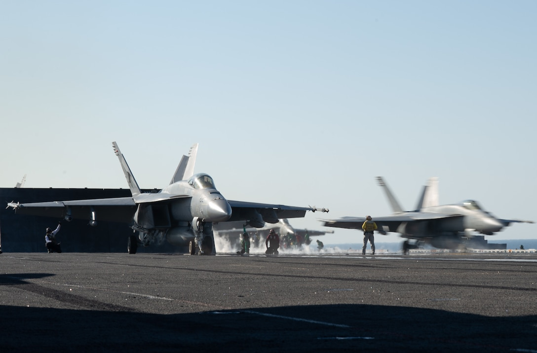 An F/A-18E Super Hornet, assigned to Strike Fighter Squadron (VFA) 14, left, prepares to launch as an F/A-18E Super Hornet, also assigned to VFA 14, launches from the flight deck aboard the aircraft carrier USS John C. Stennis (CVN 74) in the Arabian Sea, Dec. 12, 2018. The John C. Stennis Carrier Strike Group and the Essex Amphibious Ready Group are conducting integrated operations in the Arabian Sea to ensure stability and security in the Central Region, connecting the Mediterranean and the Pacific through the western Indian Ocean and three strategic choke points. (U.S. Navy photo by Mass Communication 3rd Class Grant G. Grady)