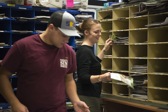 U.S. Air Force Airman 1st Class Taylor Greenwalt, left, and Staff Sgt. Emily Luzum, right, 450th Intelligence Squadron Airmen, sort mail at the North Side Post Office on Ramstein Air Base, Germany, Dec. 7, 2018. The 450th IS eased increased volume the holidays bring to the post offices on Ramstein Air Base. (U.S. Air Force Photo by Airman 1st Class Noah Coger)