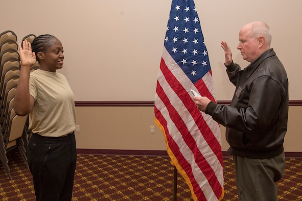 Marsha Robinson recites the oath of enlistment administered by Col. Thomas O. Pemberton, 514th Air Mobility Wing commander at Joint Base McGuire-Dix-Lakehurst, N.J., December 8, 2018. The District Court for the Northern District of California issued a ruling on November 16th, 2018, which states that the Defense Department provided no rational justification for the policy that referenced increased background checks and extended service requirements. The military services began slating recruits for training in the first week of December.
