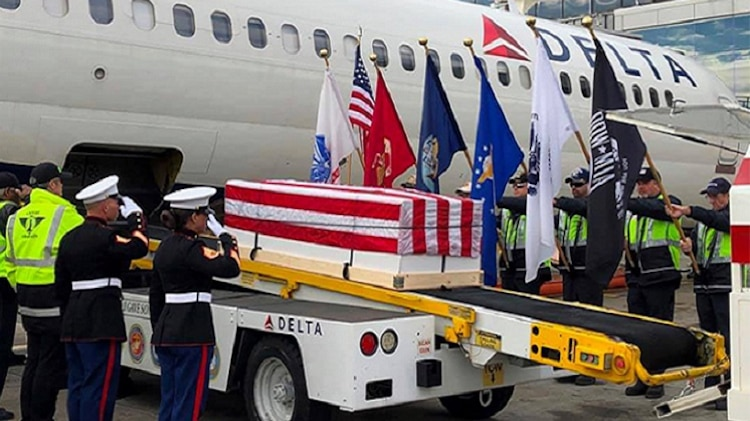 During a layover in Atlanta, Georgia, plane-side honors were delivered during the dignified transfer
