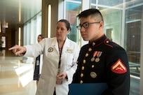 Dr. Rebecca Taylor, Defense POW/MIA Accounting Agency (DPAA) anthropologist, briefs U.S. Marine Corps Lance Cpl. Kenneth Henson during a tour of the DPAA facility at Joint Base Pearl Harbor-Hickam, Hawaii, Nov. 9, 2018. Henson visited the DPAA Laboratory to collect the remains of his grand uncle-in-law, U.S. Army Cpl. Albert Mills, who was a member of Company F, 2nd Battalion 5th Cavalry Regiment, 1st Cavalry Division during the Korean War. Henson served as the special escort for Mills' remains during transport to final resting place in Dallas. DPAA conducts global search, recovery and laboratory operations to provide the fullest possible accounting for our missing personnel to their families and the nation. (U.S. Air Force photo by Tech. Sgt. Kathrine Dodd)