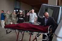 Members of the Defense POW/MIA Accounting Agency (DPAA) render honors as a mortician from a local funeral home prepares the remains of U.S. Army Cpl. Albert Mills for transport at Joint Base Pearl Harbor-Hickam, Hawaii, Nov. 9, 2018. Mills, who was a member of Company F, 2nd Battalion 5th Cavalry Regiment, 1st Cavalry Division during the Korean War, was recently identified by the DPAA Laboratory and to rest in his hometown of Dallas. DPAA conducts global search, recovery and laboratory operations to provide the fullest possible accounting for our missing personnel to their families and the nation. (U.S. Air Force photo by Tech. Sgt. Kathrine Dodd)
