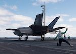 "An F-35C Lightning II assigned to the ""Argonauts"" of Strike Fighter Squadron (VFA) 147 launches from the flight deck of Nimitz-class aircraft carrier USS Carl Vinson (CVN 70)."