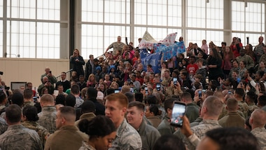 """First Lady Melania Trump visited 700 service members, DoD civilians, family members and students at Joint Base Langley-Eustis, Va., Dec. 12, 2018. """"Welcome home,"""" and thank you for answering the call of duty to the military members in the audience, said Trump. After addressing the crowd, she took time to shake their hands and pose for photographs in an aircraft hangar at the 1st Fighter Wing. (Courtesy photo by David Phillips/ Released)"""