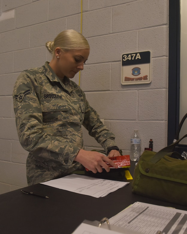 U.S Air Force Airman 1st Class Maggie Breedlove, 317th Operational Support Squadron aircrew flight equipment apprentice, inspects Emergency Passenger Oxygen Systems at Dyess Air Force Base, Texas, Dec. 12, 2018. Every week, the AFE shop has to inspect over 300 individual EPOS units to ensure they function correctly. (U.S. Air Force photo by Airman 1st Class Rebecca Van Syoc)