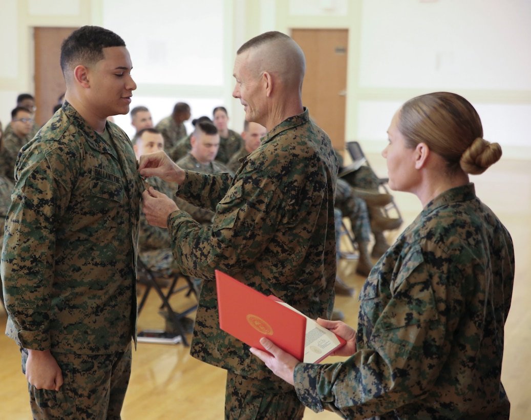 U.S. Marine Corps Brig. Gen. Stephen M. Neary, commanding general of 2nd Marine Expeditionary Brigade, presents a Navy and Marine Corps Achievement Medal to Cpl. Elijah Ballantyne, a 2nd MEB supply administrator, at Camp Lejeune, N.C., Dec. 11, 2018. Ballantyne received the award for his exemplary performance while supporting the unit during Exercise Trident Juncture 18 in Norway. The award is earned by exemplifying superior performance outside one's designated military occupational specialty. (U.S. Marine Corps photo by Cpl. Patrick Osino)
