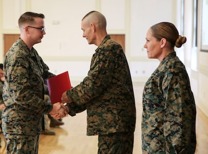 U.S. Marine Corps Brig. Gen. Stephen M. Neary, commanding general of 2nd Marine Expeditionary Brigade, presents a Navy and Marine Corps Achievement Medal to Cpl. Jordan Deisler, a 2nd MEB administrative specialist, at Camp Lejeune, N.C., Dec. 11, 2018. Deisler received the award for his exemplary performance while supporting the unit during Exercise Trident Juncture 18 in Norway. The award is earned by exemplifying superior performance outside one's designated military occupational specialty. (U.S. Marine Corps photo by Cpl. Patrick Osino)