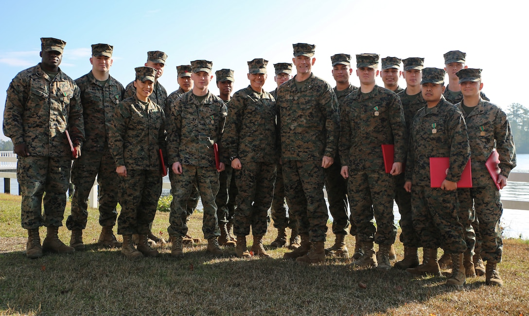 U.S. Marine Corps Brig. Gen. Stephen M. Neary, commanding general of 2nd Marine Expeditionary Brigade, stands with the unit's most recent recipients of a Navy and Marine Corps Achievement Medal at Camp Lejeune, N.C., Dec. 11, 2018. The Marines received the award for their exemplary performance while supporting the unit during Exercise Trident Juncture 18 in Norway. The award is earned by exemplifying superior performance outside one's designated military occupational specialty. (U.S. Marine Corps photo by Cpl. Patrick Osino)