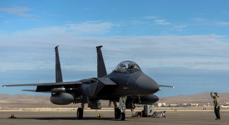 Airman 1st Class Clayton Ackerman, 757th Aircraft Maintenance Squadron Strike Aircraft Maintenance Unit F-15E Strike Eagle fighter jet maintainer, launches an F-15E during the Weapons School Integration (WSINT) Dec. 4, 2018 at Nellis Air Force Base, Nevada. Completing WSINT requires a working relationship with aircraft maintainers, whose roles in the exercise are vital. (U.S. Air Force photo by Airman 1st Class Bailee A. Darbasie)