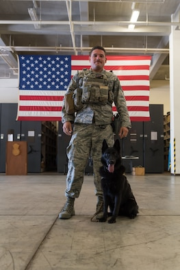 U.S. Air Force Staff Sgt. Eduardo Alcaraz, 18th Security Forces Squadron military working dog handler, and his military working dog, Sony, pose for a photo Nov. 21, 2018, at Kadena Air Base, Japan. The bond between a military working dog and its handler is founded on trust, and can become unbreakable within their time together.