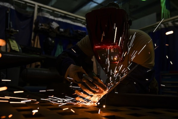 U.S. Air Force Senior Airman Courtnee Grafton, 380th Expeditionary Maintenance Squadron metal technician, welds a piece of metal at Al Dhafra Air Base, United Arab Emirates, Dec. 9, 2018. The 380th EMXS fabrication flight is in charge of identifying and repairing aircraft structural damage.  (U.S. Air Force photo by Senior Airman Mya M. Crosby)