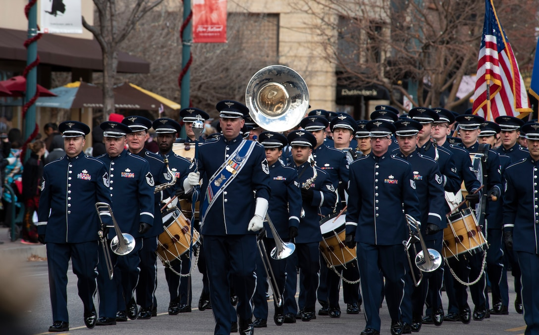 The United States Air Force Academy Band marches during the 2018 Colorado Springs Veterans Day parade in Colorado Springs, Colorado, Nov. 3, 2018. The parade honored veterans and inspired community awareness while paying tribute to the service and sacrifices many have endured in the pursuit of freedom. (U.S. Air Force photo by Staff Sgt. Matthew Coleman-Foster)