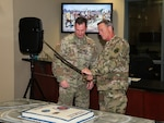 U.S. Air Force Maj. Gen. Jon K. Mott, right, U.S. Central