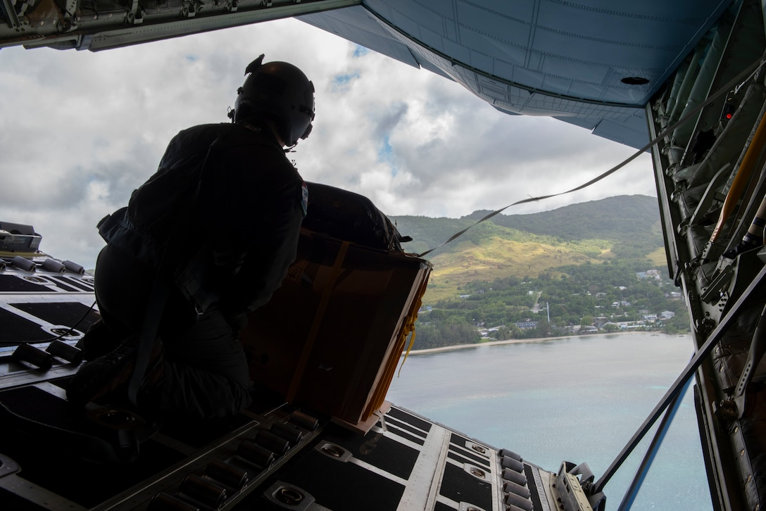 A C-130J loadmaster prepares to drop a bundle