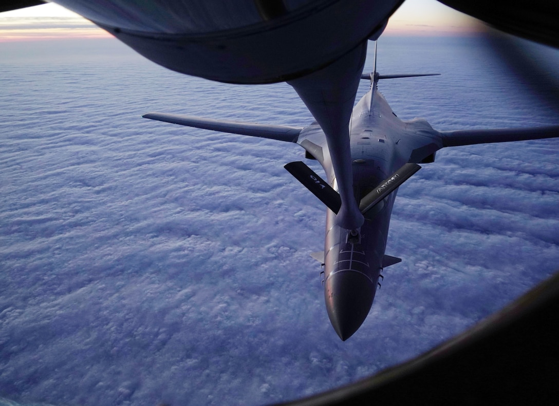 An aerial refueling of a B-1B Lancer by a KC-135