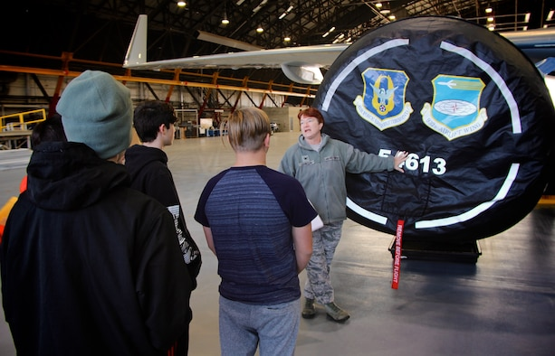 As part of a community outreach event, the 932nd Airlift Wing Maintenance Group's top officer and commander, Col. Sharon Johnson, talks about the C-40 plane, the Air Force Reserve and the 932nd Airlift Wing, to a group of eighth grade Science, Technology, Engineering, and Mathematics (STEM) students.  The students visited December 10, 2018, at Scott Air Force Base, Illinois. Johnson's group of Airmen maintain four of the C-40 aircraft belonging to the 932nd AW and operated by the 932nd Operations Group and updated by the 932nd Maintenance Group.  She and the public affairs officer escorted local Mascoutah students out to their hangar work center, to see more about how an airplane engine, wheels, tires, hydraulics, and wings work together and get a plane off the ground. Johnson and her maintainers manned informational stations as multiple groups of students rotated through various areas every 45 minutes at the reserve unit, located in southern Illinois near Belleville. (U.S. Air Force photo by Lt. Col. Stan Paregien)