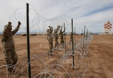 U.S Soldiers with 541st Engineer Company, Special Purpose Marine Air-Ground Task Force 7, position concertina wire on a practice barricade at Naval Air Facility El Centro in California, Dec. 4, 2018. U.S. Northern Command is providing military support to the Department of Homeland Security and U.S. Customs and Border Protection to secure the Southern border of the United States. (U.S. Marine Corps photo by Sgt. Asia J. Sorenson)