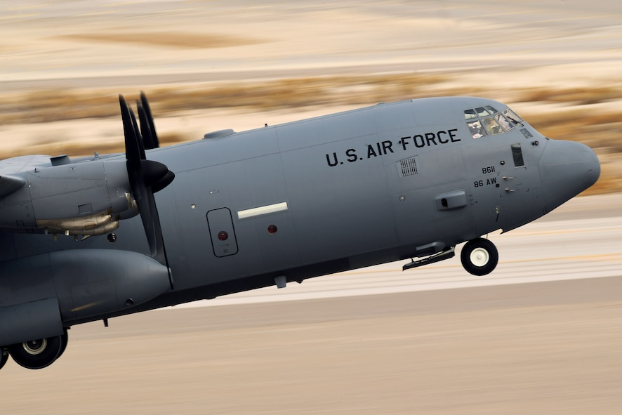 A C-130 Hercules aircraft takes off from Creech Air Force Base, Nevada, Dec. 10, 2018, as the base supported a Joint Forcible Entry exercise. The objective of this exercise is to integrate Army airborne and land operations, with joint air support, and special operations against an opposing enemy force. (U.S. Air Force Photo by Senior Airman James Thompson)