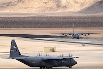 Two C-130 Hercules taxi the airfield at Creech Air Force Base, Nevada, Dec. 10, 2018. As one of the most challenging and complex missions of the year, Joint Forcible Entry exercise integrates decisive action and demonstrates crisis response as well as global mobility. (U.S. Air Force Photo by Senior Airman James Thompson)