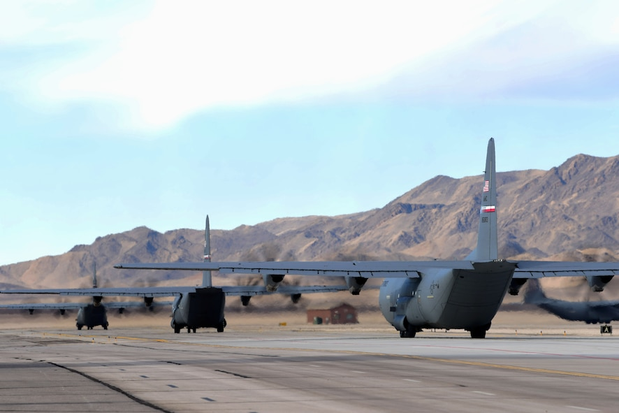 Three C-130 Hercules taxi the airfield at Creech Air Force Base, Nevada, Dec. 10, 2018. The base supported a Joint Forcible Entry exercise which integrates decisive action and demonstrates crisis response as well as global mobility. (U.S. Air Force Photo by Airman 1st Class Haley Stevens)