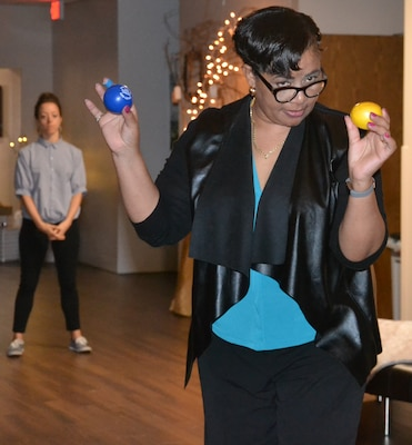 """Darlene Taylor, Suicide Prevention Program manager at the Vogel Resiliency Center at Joint Base San Antonio-Fort Sam Houston, demonstrates how stress balls can be used to relieve stress during """"The Gift of Presence: Resiliency Reset"""" event at the center Nov. 30."""