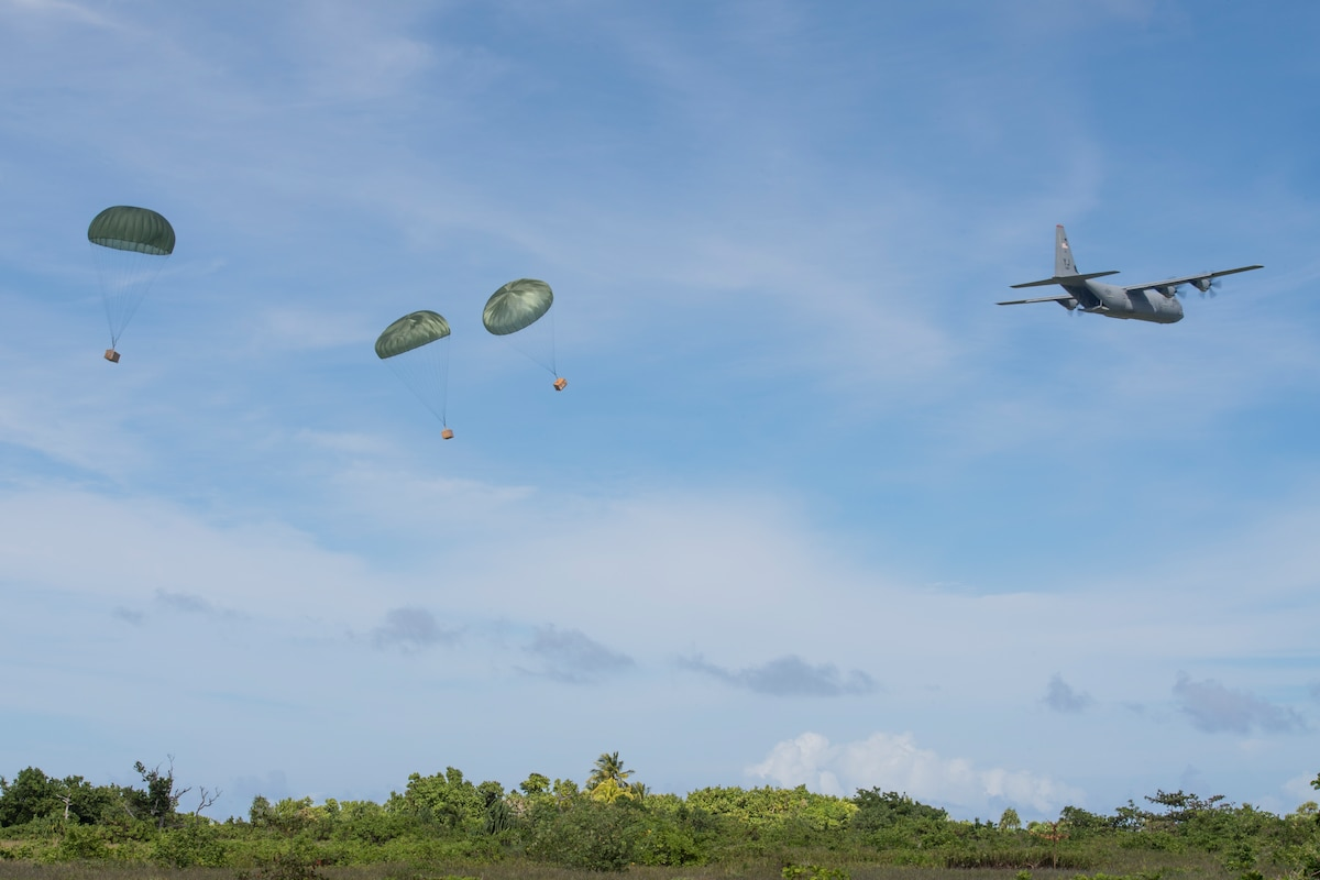 A C-130 drops supplies during Operation Christmas Drop 2018.
