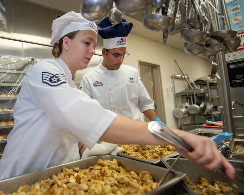 U.S. Air Force Staff Sgt. Janna Turner, left, and Senior Airman Christopher Weise, 133rd Force Support Squadron, Sustainment Services Flight, prep food for the Wing holiday meal at the dining facility in St. Paul, Minn., Nov. 11, 2018.