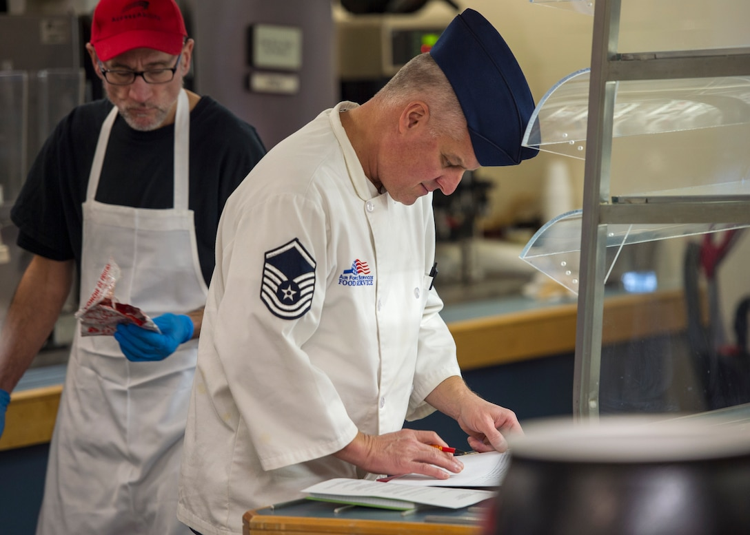 U.S. Air Force Master Sgt. John Giese, 133rd Force Support Squadron, Sustainment Services Flight, checks the quality of the food for the Wing holiday meal at the dining facility in St. Paul, Minn., Nov. 11, 2018.